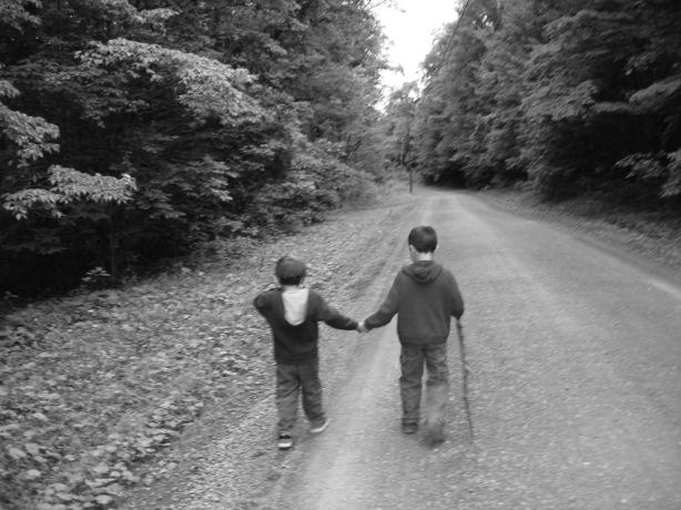 boys-walking-on-raod-bw