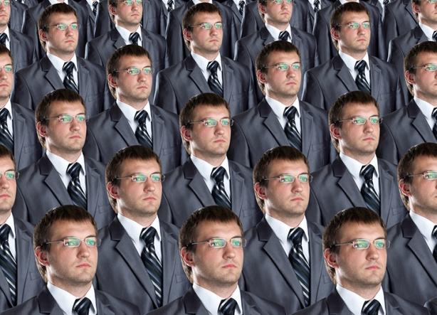 Many identical businessmen clones. Businessman production concept